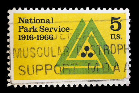 national parks: UNITED STATES OF AMERICA - CIRCA 1966: A used postage stamp printed in United States commemorates the National Park Service, circa 1966. This agency manages all U.S. national parks, many monuments, conservation and historical properties.