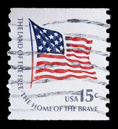 flapping: UNITED STATES OF AMERICA - CIRCA 1978: A used postage stamp printed in United States shows a flapping flag of USA over Government buildings, circa 1978