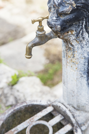 deficits: An old iron rusty faucet. Water lack is one of largest world problems. Today, nearly 1 billion people in the developing world dont have access to it Stock Photo