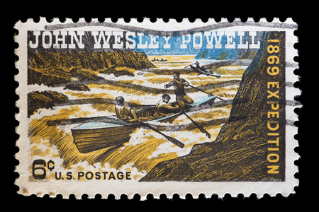 wesley: UNITED STATES OF AMERICA - CIRCA 1969: A used postage stamp printed in United States shows the soldier, geologist, explorer John Wesley Powell facing the rapids of a river on a canoe, circa 1969