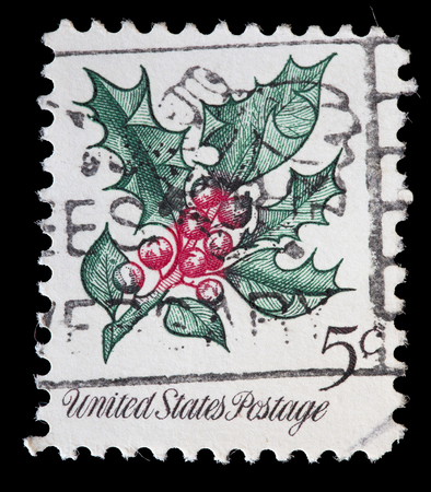 postage: UNITED STATES OF AMERICA - CIRCA 1964: A used postage stamp printed in United States shows a plant of butchers-broom, Ruscus aculeatus, commonly used as Christmas decorations, circa 1964 Editorial