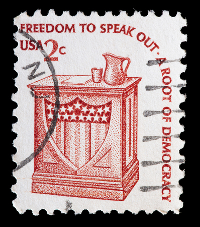 speak out: UNITED STATES OF AMERICA - CIRCA 1977: A used postage stamp printed in United States shows a electoral pulpit to represent the freedom to speak out as root of democracy, circa 1977