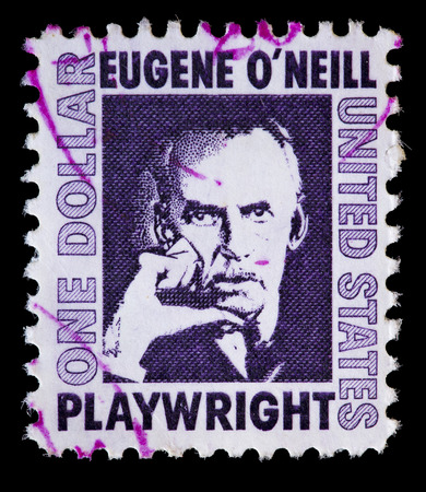 eugene: UNITED STATES OF AMERICA - CIRCA 1967: A used postage stamp printed in United States shows portrait of playwright Eugene O Neill on violet background, circa 1967