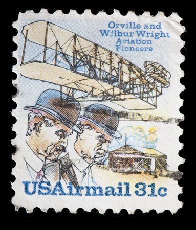 pioneers: UNITED STATES OF AMERICA - CIRCA 1978: A used air mail postage stamp printed in United States shows the aviation pioneers Wright brothers, Orville and Wilbur, with an old aircraft on the background, circa 1978