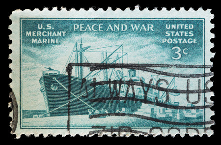 contribution: UNITED STATES OF AMERICA - CIRCA 1946: A used postage stamp printed in United States shows a freighter vessel from merchant marine to commemorate the Contribution to Commercial Fleet in World War II, circa 1946