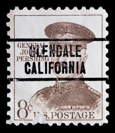 pershing: UNITED STATES OF AMERICA - CIRCA 1961: A used postage stamp printed in United States shows a portrait of the General John Pershing in brown , circa 1961