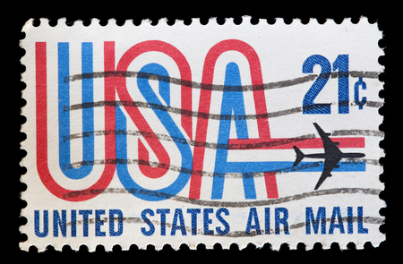 postage: UNITED STATES OF AMERICA - CIRCA 1971: A used postage stamp printed in United States shows an airplane flying over the word USA with the colors of national flag, circa 1971