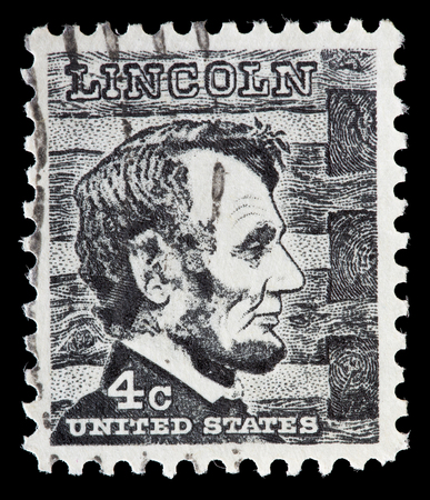 abraham: UNITED STATES OF AMERICA - CIRCA 1965: A used postage stamp printed in United States shows a portrait of the President Abraham Lincoln on gray black background, circa 1965