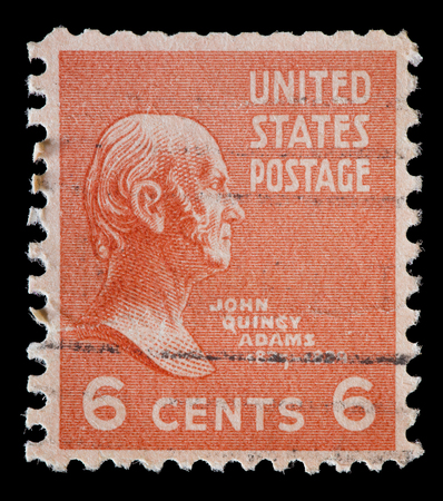 adams: UNITED STATES OF AMERICA - CIRCA 1938: A used postage stamp printed in United States shows a portrait of the President John Quincy Adams on red orange background, circa 1938
