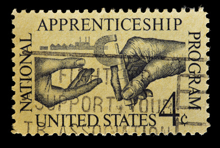 apprenticeship: UNITED STATES OF AMERICA - CIRCA 1962: A used postage stamp printed in United States commemorates the National Apprenticeship Program, circa 1962