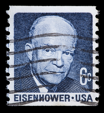 eisenhower: UNITED STATES OF AMERICA - CIRCA 1970: A used postage stamp printed in United States shows a portrait of the President Dwight D. Eisenhower on blue grey background, circa 1970 Editorial