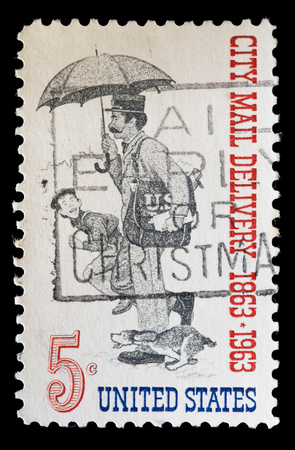 united states postal service: UNITED STATES OF AMERICA - CIRCA 1963: A used postage stamp printed in United States shows a postman with umbrella and a dog during city mail delivery, circa 1963 Editorial