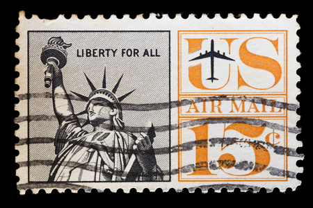 airmail: UNITED STATES OF AMERICA - CIRCA 1961: A used airmail postage stamp printed in United States shows an airplane flying near the Statue of Liberty, circa 1961