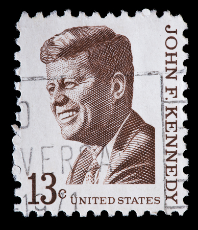 john fitzgerald kennedy: UNITED STATES OF AMERICA - CIRCA 1967: A used postage stamp printed in United States shows a portrait of the President John Fitzgerald Kennedy in brown , circa 1967