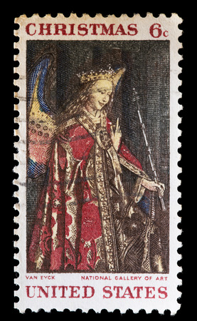 angel gabriel: UNITED STATES OF AMERICA - CIRCA 1968: A used postage stamp printed in United States shows a biblical paiting from Jan Van Eyck depicting Angel Gabriel, circa 1968 Editorial