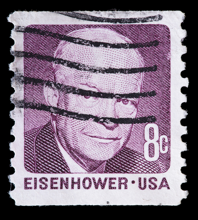 eisenhower: UNITED STATES OF AMERICA - CIRCA 1971: A used postage stamp printed in United States shows a portrait of the President Dwight D. Eisenhower on pale brown background, circa 1971