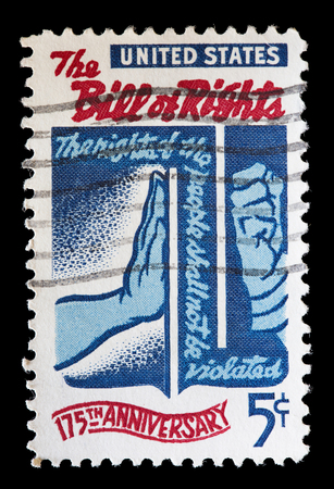 bill of rights: UNITED STATES OF AMERICA - CIRCA 1966: A used postage stamp printed in United States shows the hand of a man used to stop another aggressive man to commemorate the bill of rights, circa 1966 Editorial