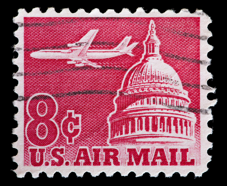 jetliner: UNITED STATES OF AMERICA - CIRCA 1962: A used postage stamp printed in United States shows a jetliner in flight over Capitol Building in Washington, D.C., circa 1962