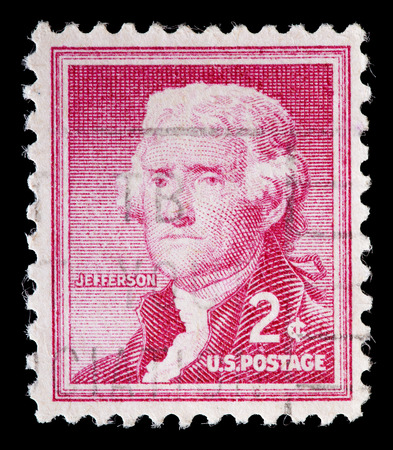 used stamp: UNITED STATES OF AMERICA - CIRCA 1954: A used postage stamp printed in United States shows a portrait of the President Thomas Jefferson on red background, circa 1954