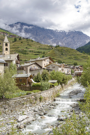 bordering: Scenic view of a typical town in Valtellina, a valley in the Lombardy region of northern Italy, bordering Switzerland along the Adda river Stock Photo