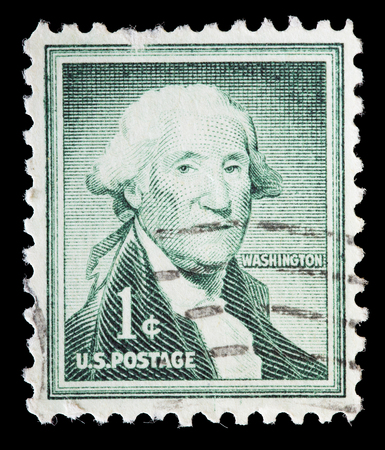 george washington: UNITED STATES OF AMERICA - CIRCA 1954: A used postage stamp printed in United States shows a portrait of the President George Washington on dark green background, circa 1954