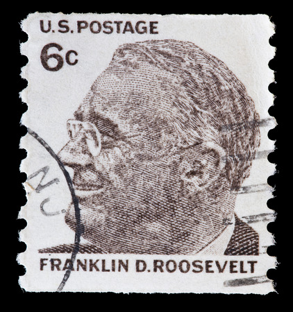 UNITED STATES OF AMERICA - CIRCA 1968: A used postage stamp printed in United States shows a portrait of the President Franklin Delano Roosevelt in brown, circa 1968