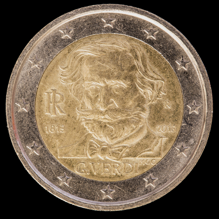 circulated: A commemorative circulated two euro coin issued by Italy in 2013 and commemorating the anniversary of birth of the Italian composer of operas Giuseppe Verdi. Image isolated on black background.