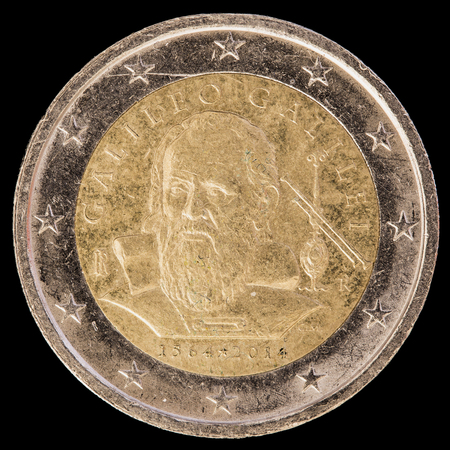 physicist: A commemorative circulated two euro coin issued by Italy in 2014 to celebrate the Italian astronomer, physicist, engineer and mathematician Galileo Galilei. Image isolated on black background.