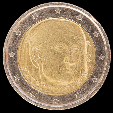 circulated: A commemorative circulated two euro coin issued by Italy in 2013 and commemorating the anniversary of birth of the Italian poet Giovanni Boccaccio. Image isolated on black background. Stock Photo