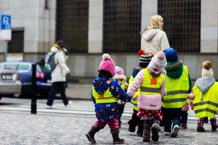 young children walking on a school trip to Prague Stock Photo
