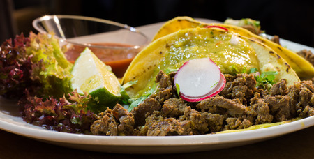 Mexican tacos with beef, onion and vegetables Stock Photo