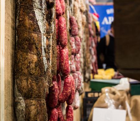 ahorcada: different types of Italian salami hanging in a restaurant