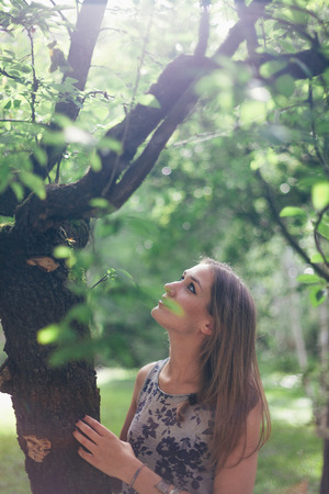lean over: Beauty Portrait About a Real Woman in Nature Stock Photo