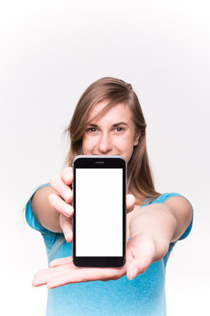 hold: Young Pretty Girl Shows Her phone White Background