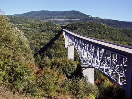helens: Long bridge leading to Mt. St. Helens in Washington.                                Stock Photo