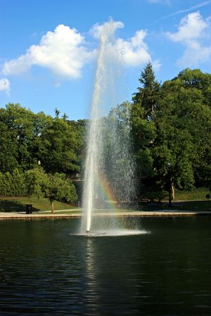 Water fountain with a rainbow through it.                        Stock Photo