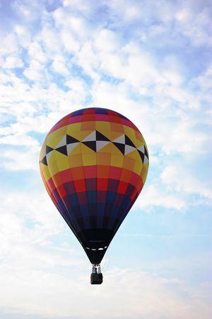 Hot air balloon flying through the air.