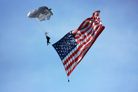 Skydiver with an American flag Stock Photo