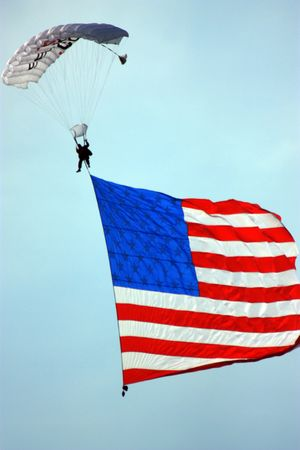 Skydiver jumping with an American flag