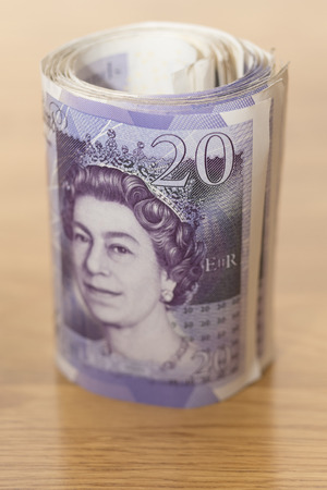 rolled: Twenty  pound notes rolled up Stock Photo