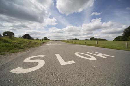 road marking: SLOW, UK road marking