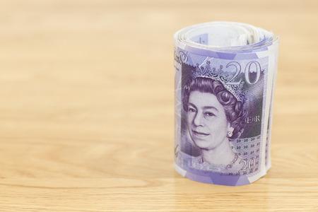 twenty: Twenty  pound notes rolled up Stock Photo