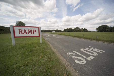 bumpy road: Slow down, bumpy road ahead.
