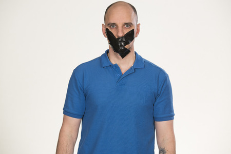 gagged: Gagged man unable to speak Stock Photo