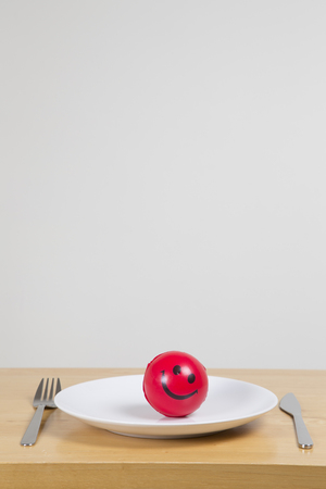 stress ball: Weight loss concept, stress ball on white plate Stock Photo