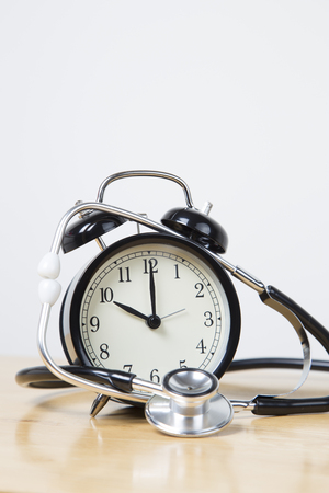 Alarm colock with stethoscope - patient waiting time concept