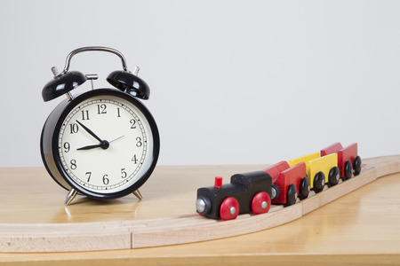 delays: Train going infront of clock, delays concept