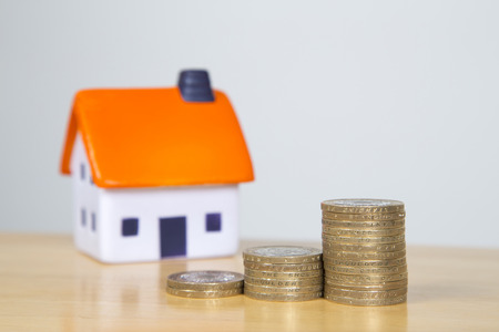 Home ownership, inflation concept - money stack in increaseing amounts Stock Photo