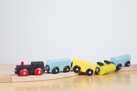 Derailed toy train - Conceptual image failure, out of control Фото со стока