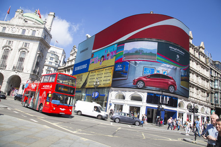 piccadilly: LONDON, UK - AUG 12, 2016. site seeing bus passes large screen in piccadilly circus